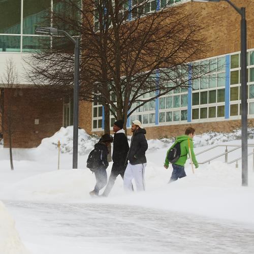 Students Walking around campus in the snow