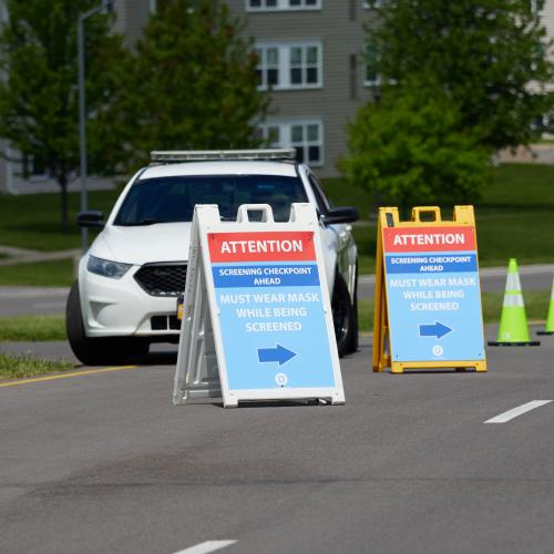 Campus Safety parked next to signs