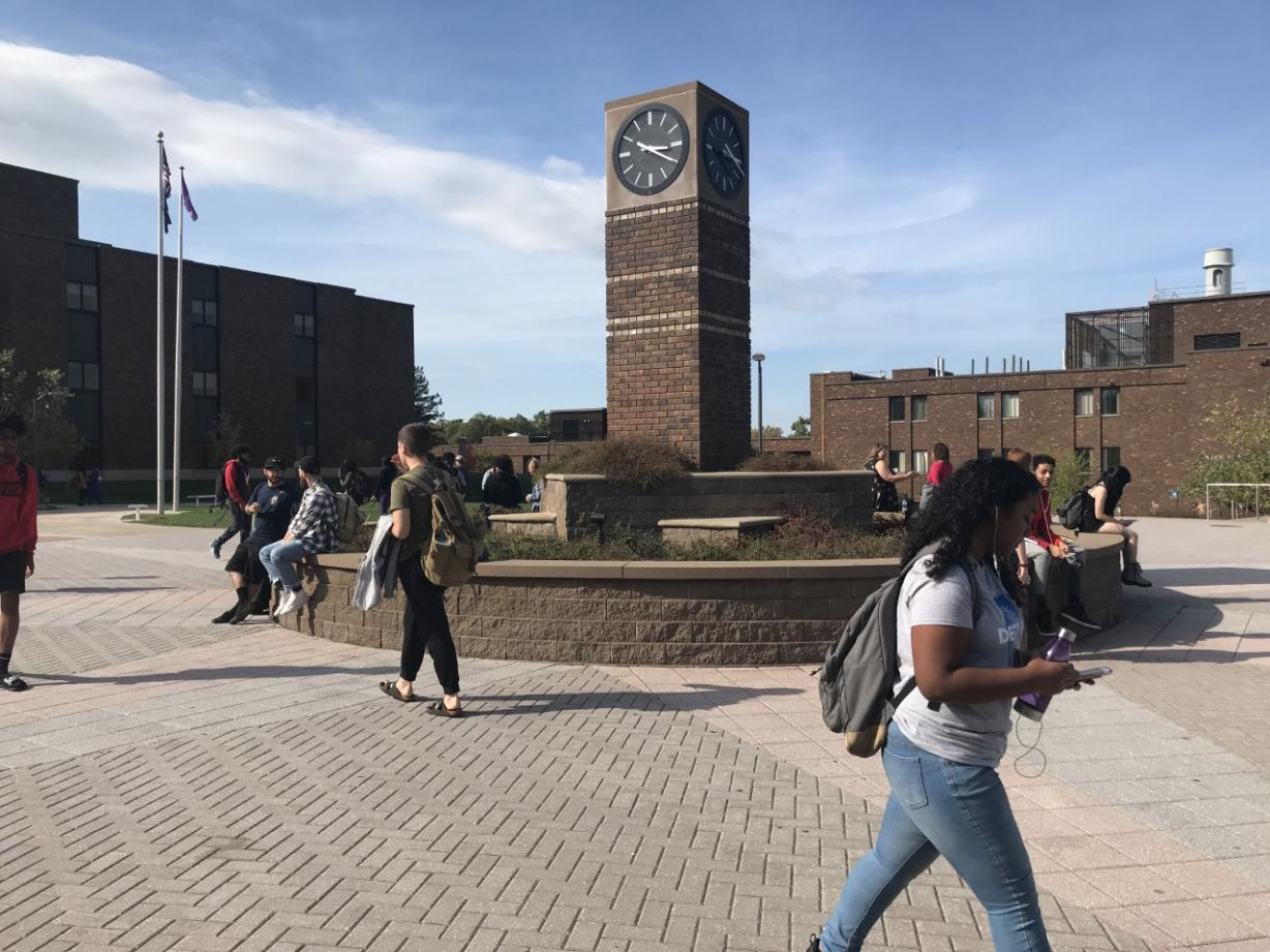 Clock Tower on OCC Campus with Students Walking Around