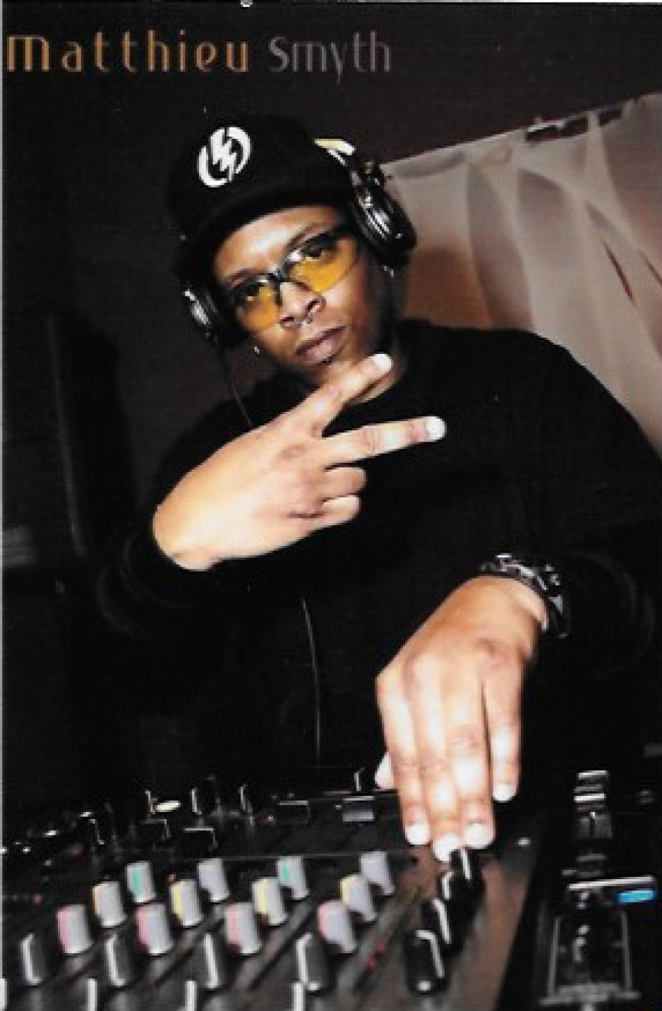 Reggie Manuel at work as DJ Highlander.
