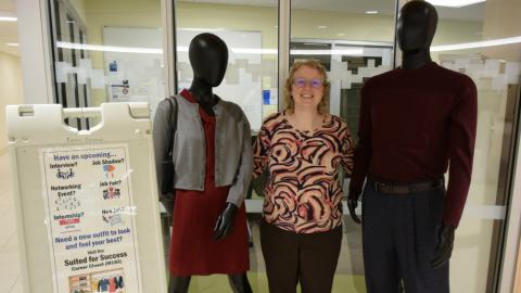 Abbey Baird is Director of OCC's Career Services Office. She's pictured in Coulter Hall with mannequins whose clothes are changed regularly to show students different ways to dress for success.