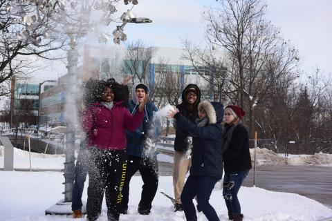Students Having fun in the Snow