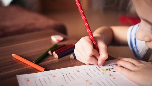 Young child writing
